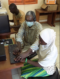 Christophe Oulé from the Blind Association UN-ABPAM Burkina Faso trains a student in accessible technology on the computer.